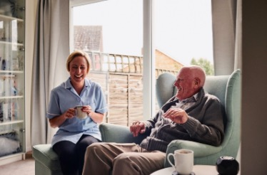 Retired Couple Laughing at Home